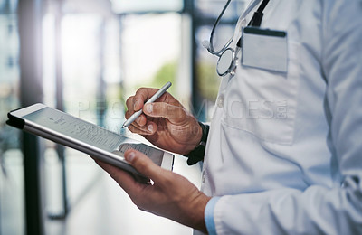 Buy stock photo Cropped shot of a young medical practitioner working in a hospital