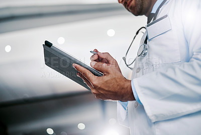 Buy stock photo Cropped shot of an unrecognizable medical practitioner working in a hospital