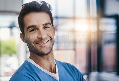 Buy stock photo Portrait of a young handsome male medical practitioner working in a hospital