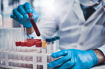 Buy stock photo Cropped shot of an unrecognizable scientist working in a lab