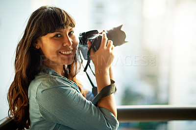Buy stock photo Shot of a woman taking pictures with her camera outside