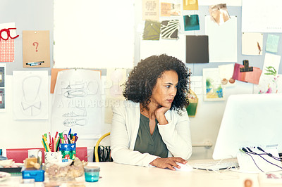 Buy stock photo Cropped shot of a designer working on her computer in her office