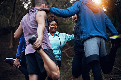 Buy stock photo Cropped shot of a sporty young group of friends working out in the forest