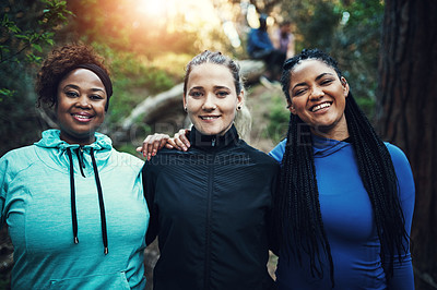 Buy stock photo Portrait of sporty young women working out in the forest