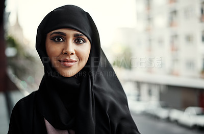 Buy stock photo Cropped portrait of an attractive young businesswoman dressed in Islamic traditional clothing standing on her office balcony