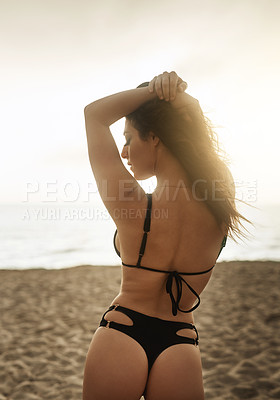 Buy stock photo Shot of a gorgeous young woman on the beach