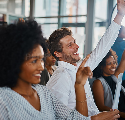 Buy stock photo Cropped shot of a group of young businesspeople sitting with their hands raised during a seminar in the conference room