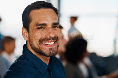 Buy stock photo Cropped portrait of a handsome young businessman sitting in the conference room during a seminar