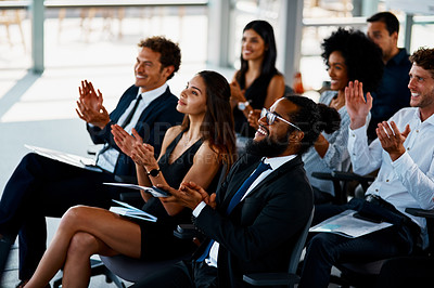 Buy stock photo Cropped shot of a group of young businesspeople applauding during a seminar in the conference room