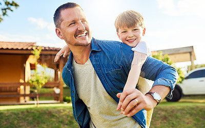 Buy stock photo Shot of a father bonding with his little son outdoors