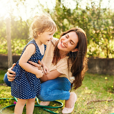 Buy stock photo Shot of a mother bonding with her adorable little daughter outdoors