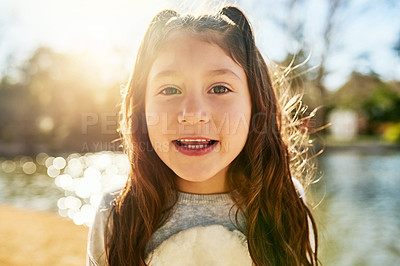 Buy stock photo Portrait of an adorable little girl next to a lake