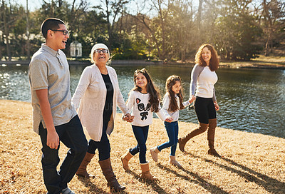 Buy stock photo Shot of a happy multigenerational family spending time together outdoors