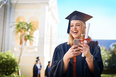 Buy stock photo Cropped shot of a happy young woman standing outside on graduation day
