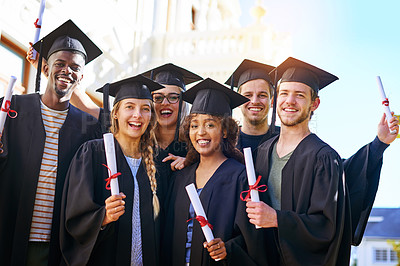 Buy stock photo Shot of happy students on graduation day