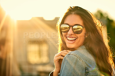 Buy stock photo Portrait of a happy and attractive young woman outdoors