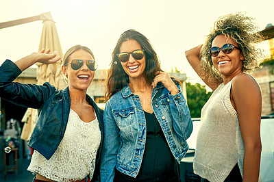 Buy stock photo Shot of a group of young women hanging out together outdoors