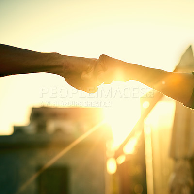 Buy stock photo Cropped shot of two men fist bumping outdoors
