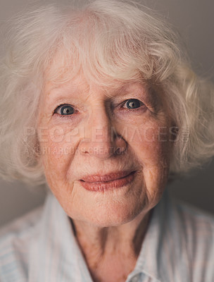Buy stock photo Portrait of a senior woman against a gray background