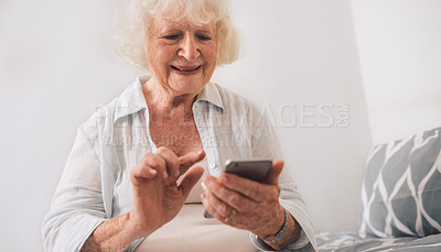 Buy stock photo Shot of a senior woman using a mobile phone in a retirement home