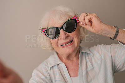 Buy stock photo Portrait of a happy senior woman wearing sunglasses in a retirement home