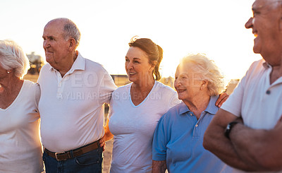 Buy stock photo Shot of a group of seniors out for a walk on the promenade