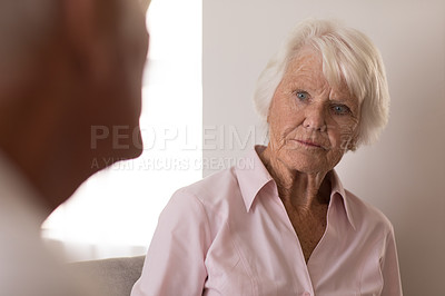 Buy stock photo Shot of a senior woman talking to a man at a retirement home