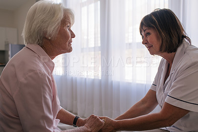 Buy stock photo Shot of a senior woman and a nurse caring for her in a retirement home