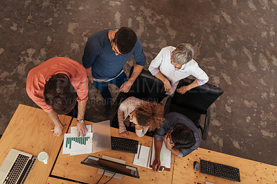 Buy stock photo High angle shot of a group of businesspeople working together in an office