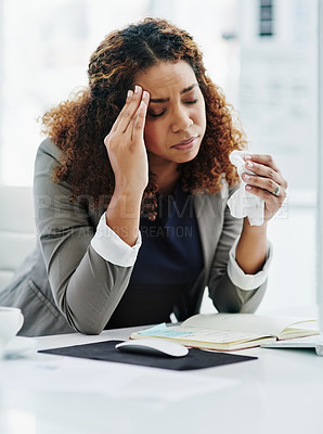 Buy stock photo Cropped shot of a young businesswoman suffering with hayfever while working at her desk in the office