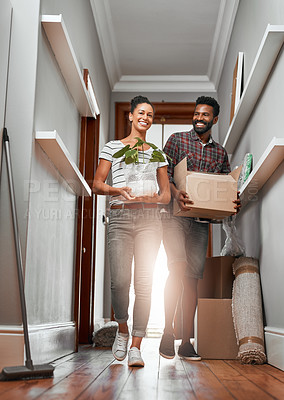 Buy stock photo Shot of a young couple moving into a new home