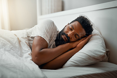 Buy stock photo Cropped shot of a handsome young man sleeping in bed at home