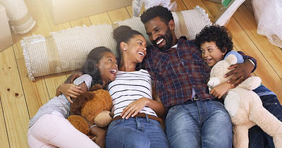 Buy stock photo Cropped shot of a young family taking a break in their new home