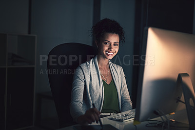 Buy stock photo Portrait of a young businesswoman working late on a computer in an office
