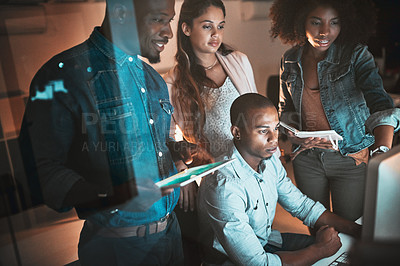 Buy stock photo Cropped shot of a group of young designers working together on a computer in their office