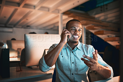 Buy stock photo Cropped shot of handsome young male designer making a phonecall while working in the office
