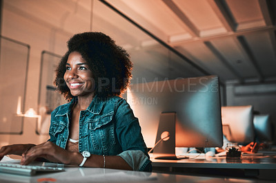Buy stock photo Cropped shot of an attractive young female designer looking confident while working on her computer in the office