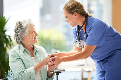 Buy stock photo Cropped shot of a female carer at a nursing home with her senior patient