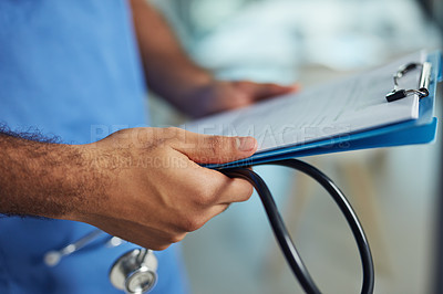 Buy stock photo Closeup shot of an unrecognizable medical practitioner holding a clipboard and stethoscope in a hospital