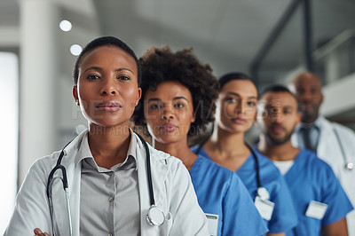 Buy stock photo Portrait of a group of medical practitioners standing in a line in a hospital