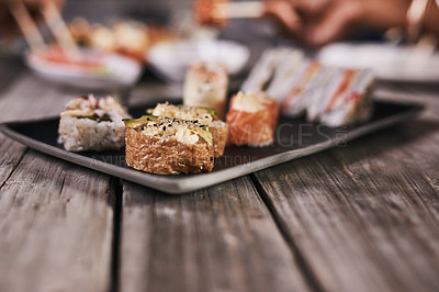Buy stock photo Cropped shot of a variety of sushi on a plate