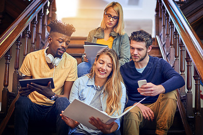 Buy stock photo Cropped shot of a group of diverse university students working together on the staircase on campus