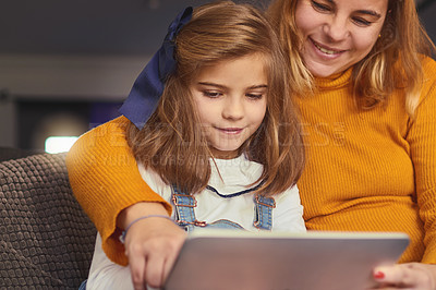 Buy stock photo Shot of a mother and daughter using a digital tablet together