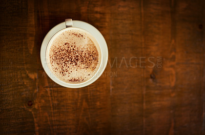 Buy stock photo High angle shot of a freshly brewed cup of coffee standing on a table by it's own inside of a restaurant