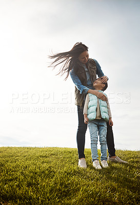 Buy stock photo Shot of a mother embracing her daughter from behind