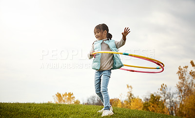 Buy stock photo Shot of an adorable little girl spending the day outdoors