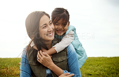 Buy stock photo Cropped shot of a little girl embracing her mother from behind