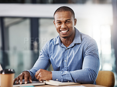Buy stock photo Portrait of a handsome young businessman working in his office