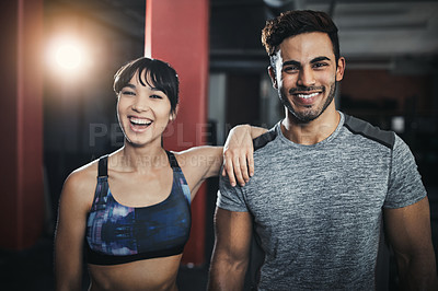 Buy stock photo Shot of young people working out in the gym