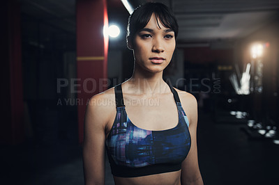 Buy stock photo Shot of a beautiful young woman at the gym for a workout